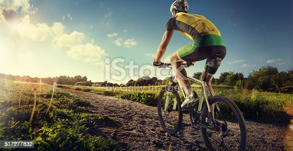 istock Cyclist riding a bike to the sunset on the ofroad 517277832