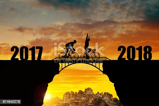 istock Cyclist riding across the bridge into the New Year 2018. 874940276
