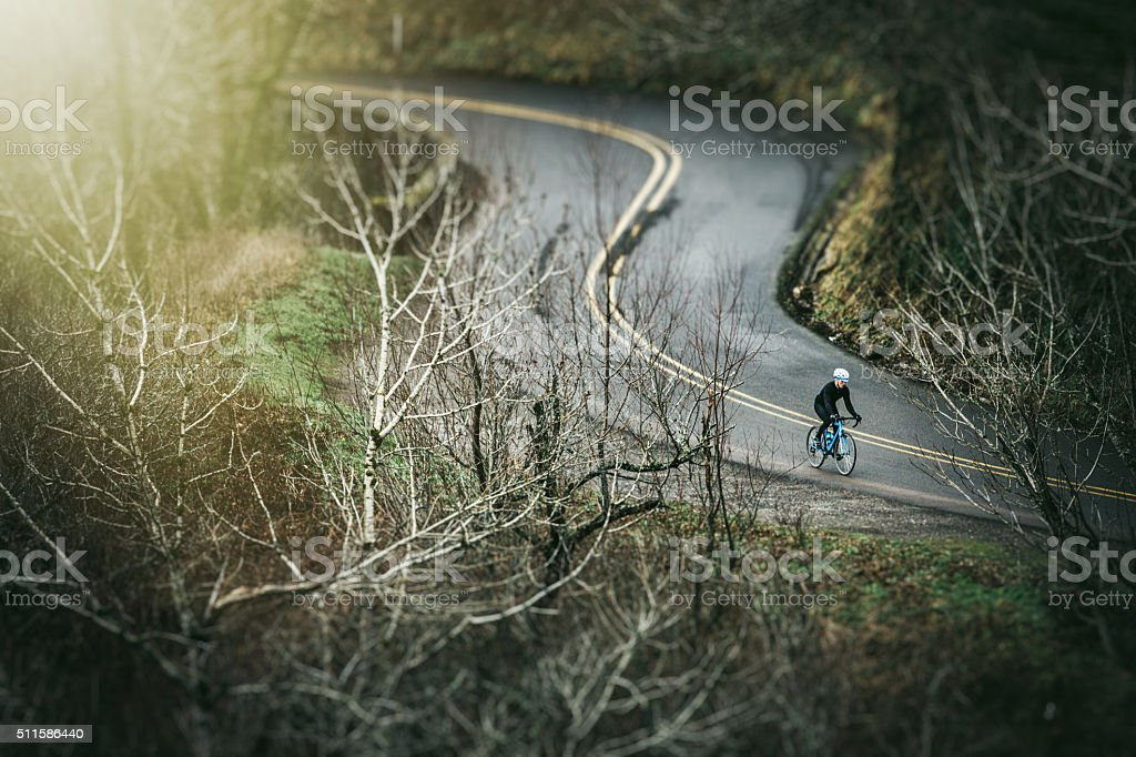 Cyclist Riding Historic Highway stock photo