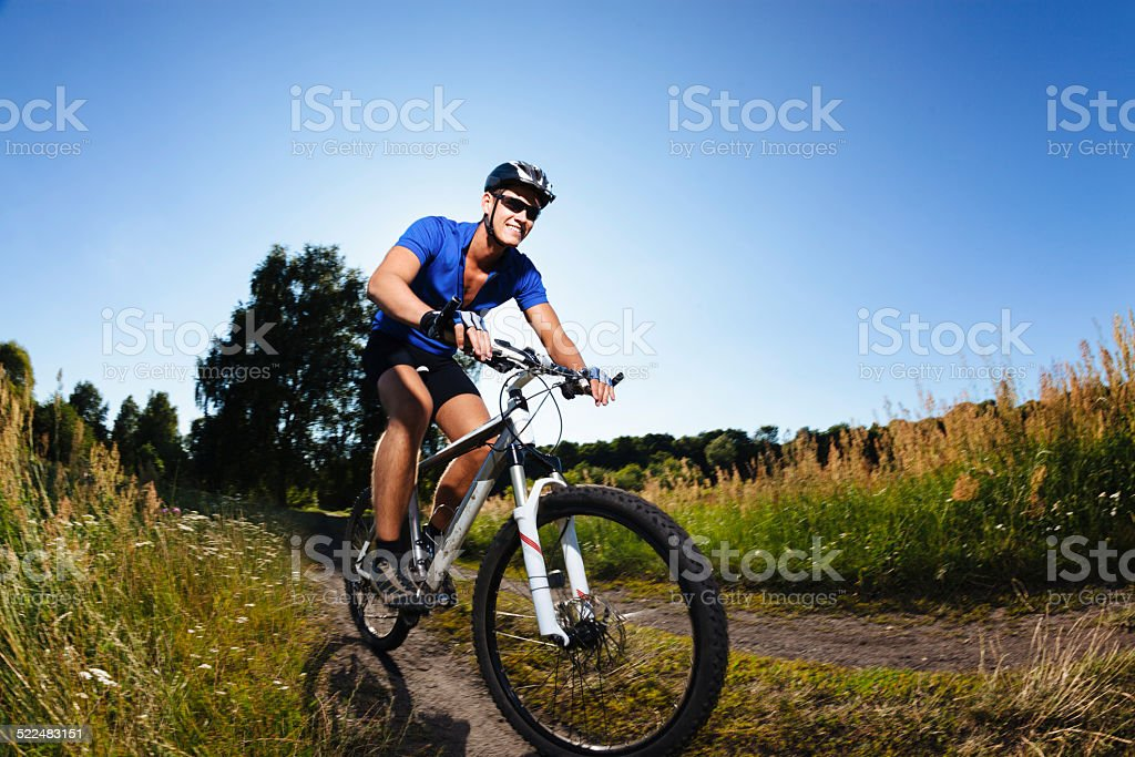 Cyclist riding mountain bike stock photo
