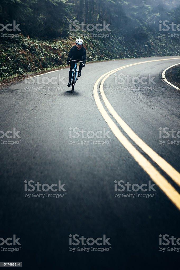 Cyclist Riding Mountain Road stock photo