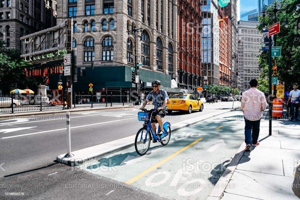 Cyclist riding on bike lane in New York stock photo