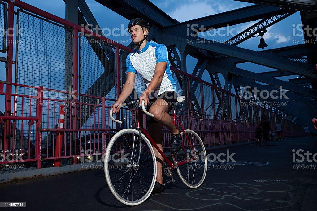 Cyclist riding on bridge stock photo