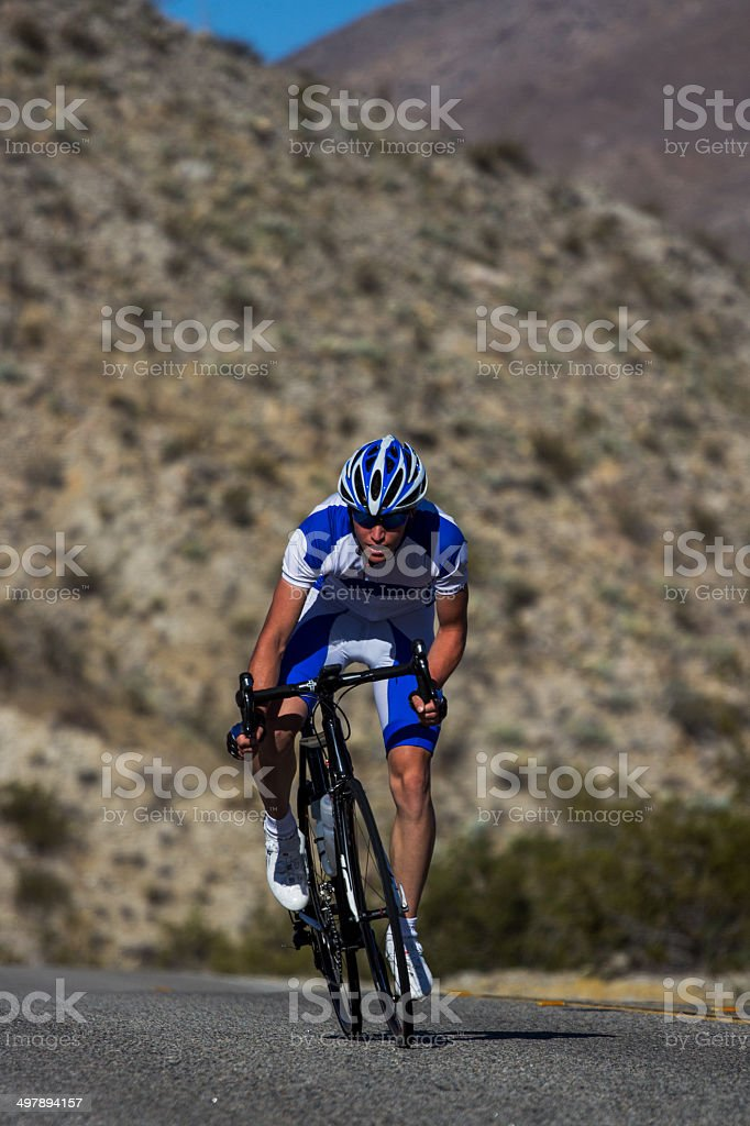 Cyclist Riding Through Mountains royalty-free stock photo