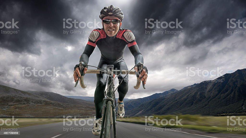 Cyclist Riding Through Storm stock photo