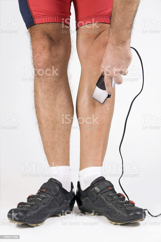 cyclist shaving her legs royalty-free stock photo