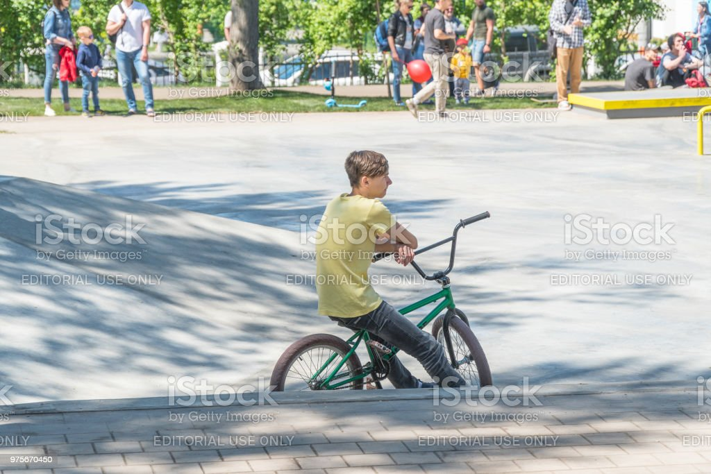 Cyclist sitting on a BMX bike in the Park stock photo