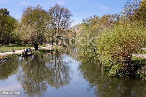 istock Cyclist talking to an angler on a wooden jetty 1259001558
