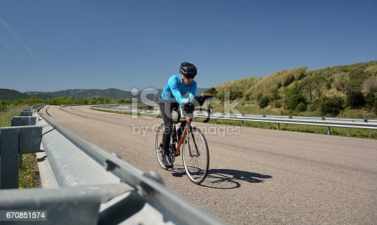 cyclist training on a lonely road during the day