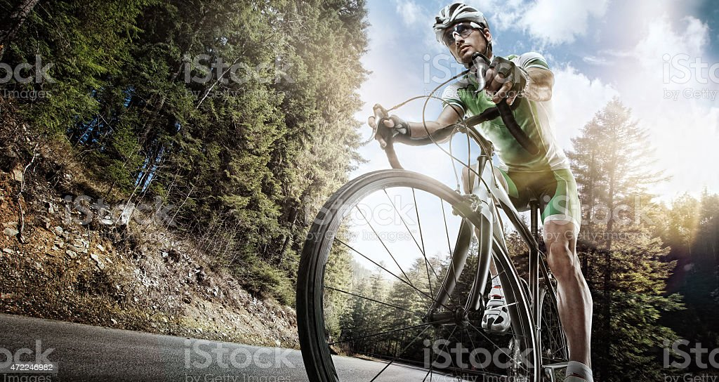 Cyclist training on a mountain road stock photo