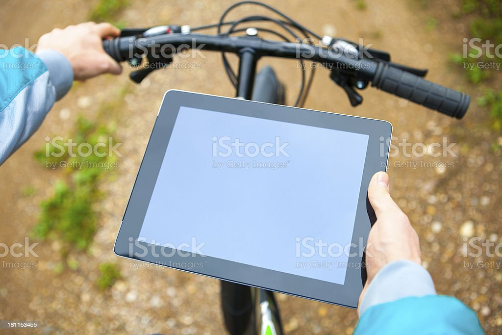 Cyclist uses digital tablet royalty-free stock photo