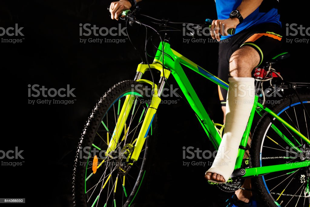 Cyclist with fracture of heel stock photo