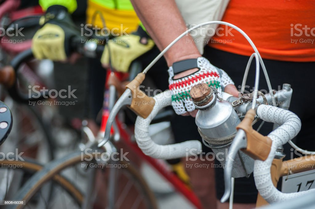 Cyclist with his vintage bicycle, before the race stock photo