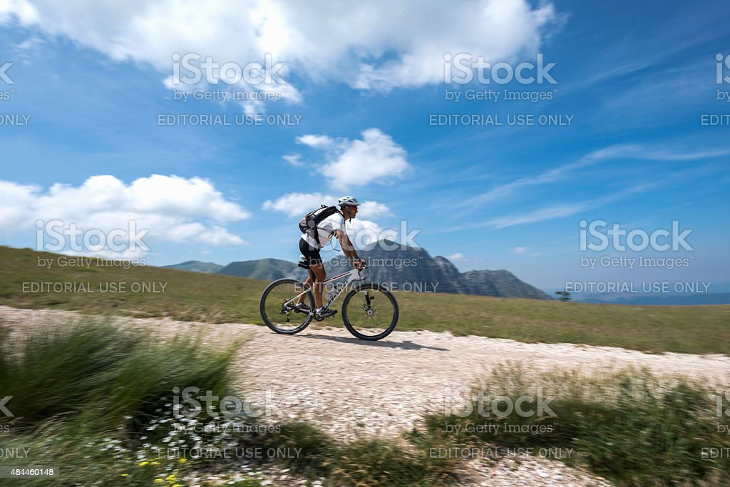 cyclist with mountain biking in the mountains stock photo