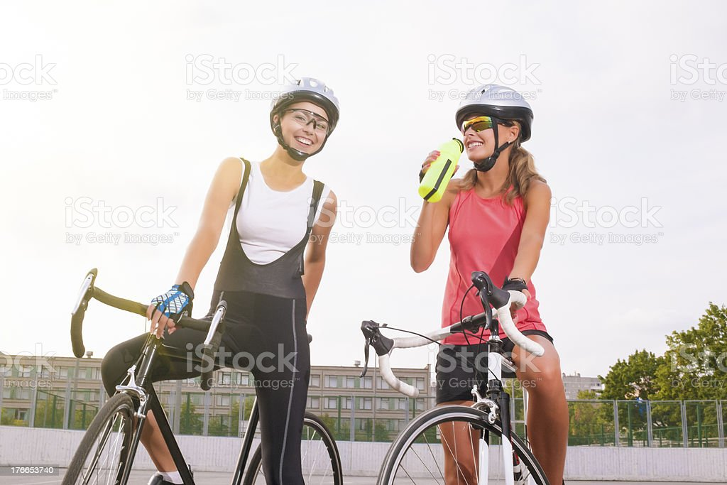 Cyclist woman takes a water break royalty-free stock photo