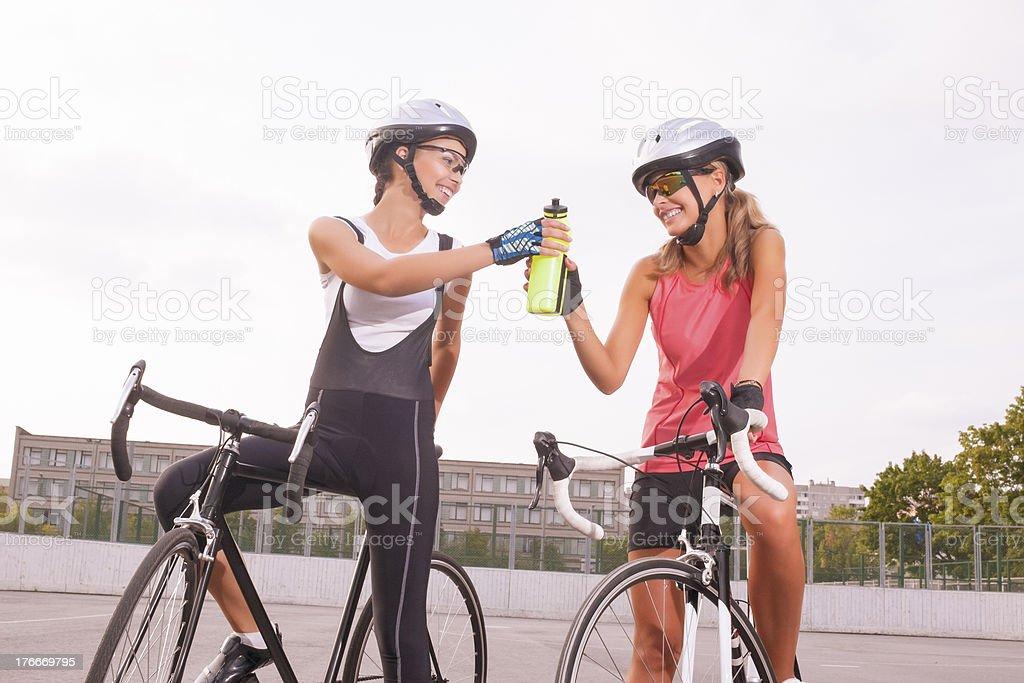 Cyclist woman takes a water break royalty-free stock photo