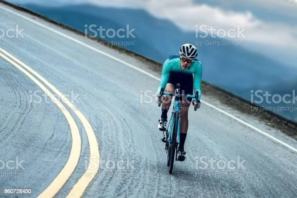 Photo of Cyclists are cycling, climbing up to the top.