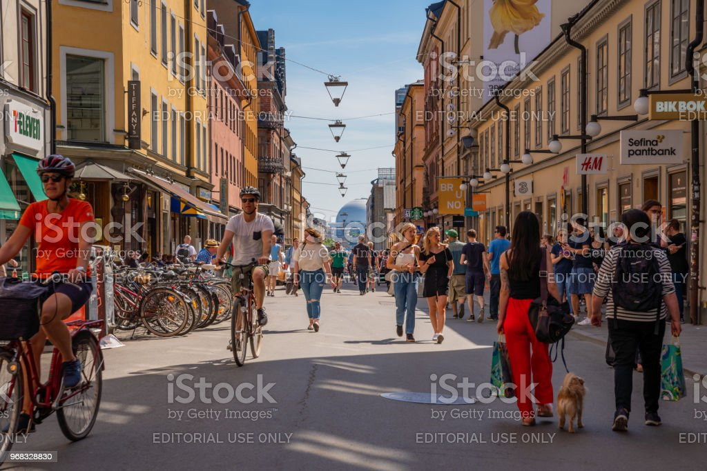 Cyclists at a pedestrian city shopping street. stock photo