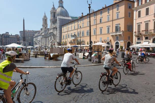 Cyclists at Piazza Navona stock photo