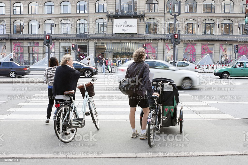 Cyclists at traffic lights stock photo
