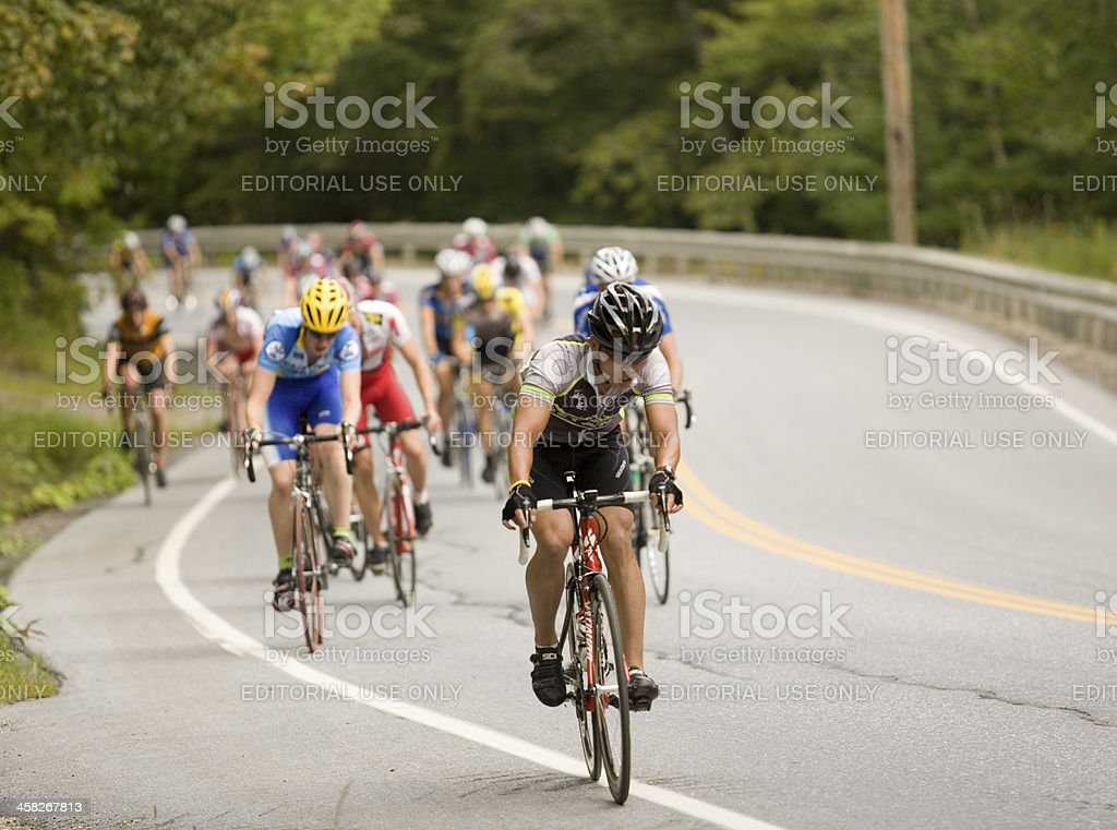 Cyclists Climbing aSteep Hill stock photo