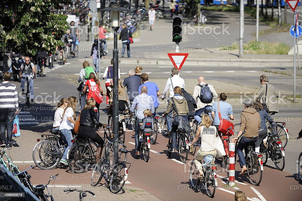 Cyclists crossing street in Utrecht royalty-free stock photo