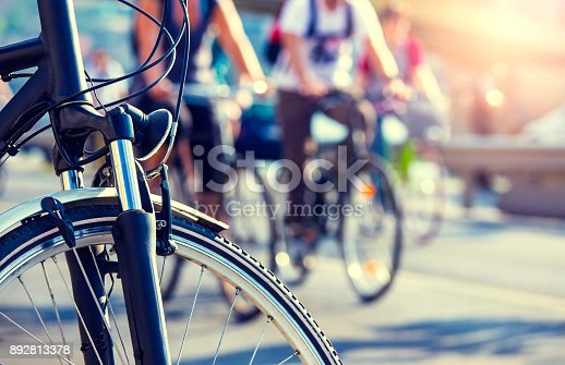 cyclists in the city in backlit wit blurry background