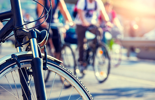 istock cyclists in the city 892813378