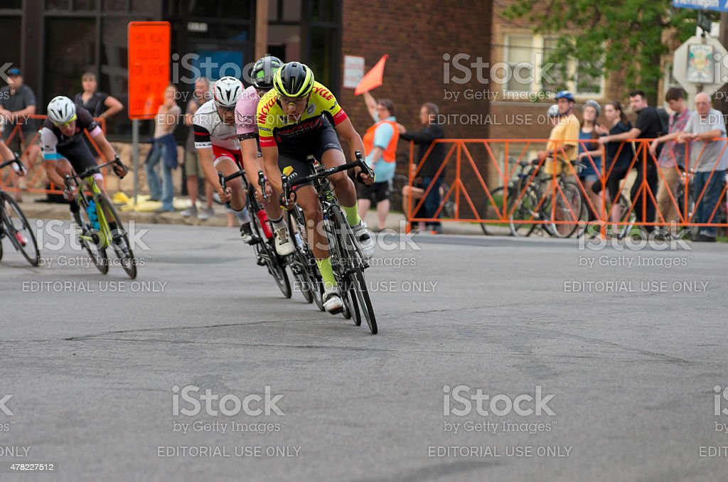 Cyclists Lead Pack at Uptown Criterium stock photo