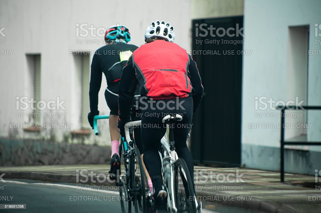 Cyclists on an urban road. stock photo