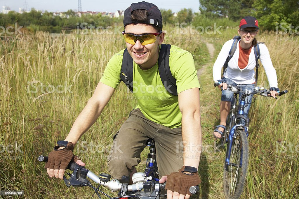 cyclists on meadow royalty-free stock photo