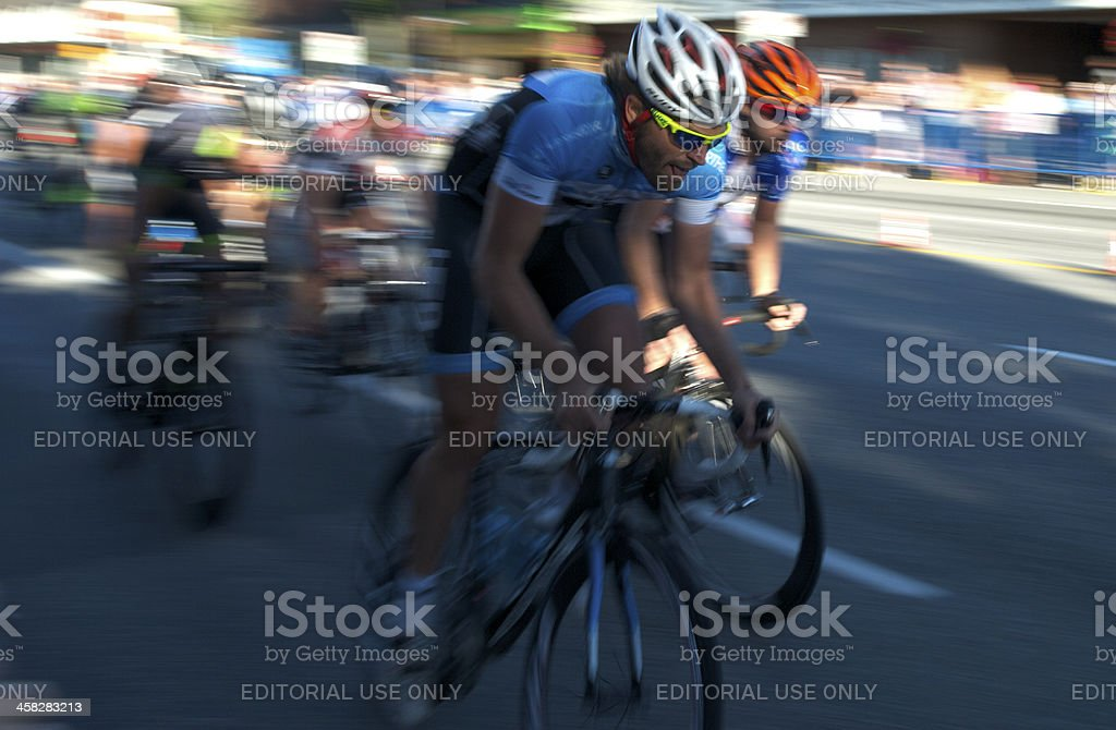 Cyclists racing in the evening sun stock photo