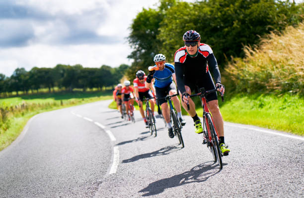 Cyclists racing on country roads. stock photo