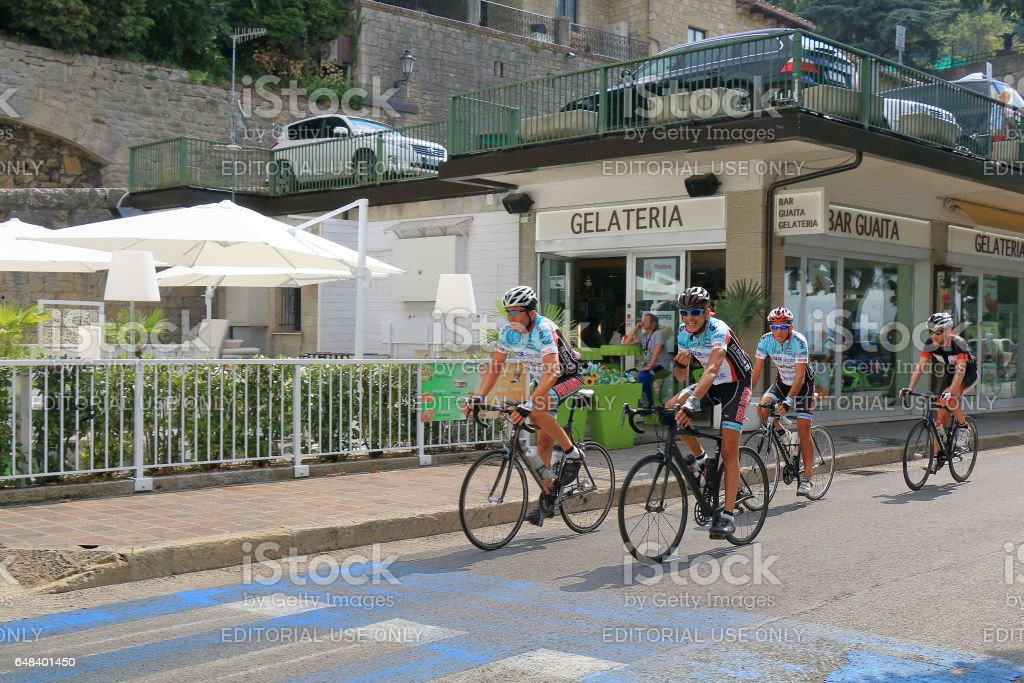 Cyclists riding on the street in San Marino, Italy stock photo