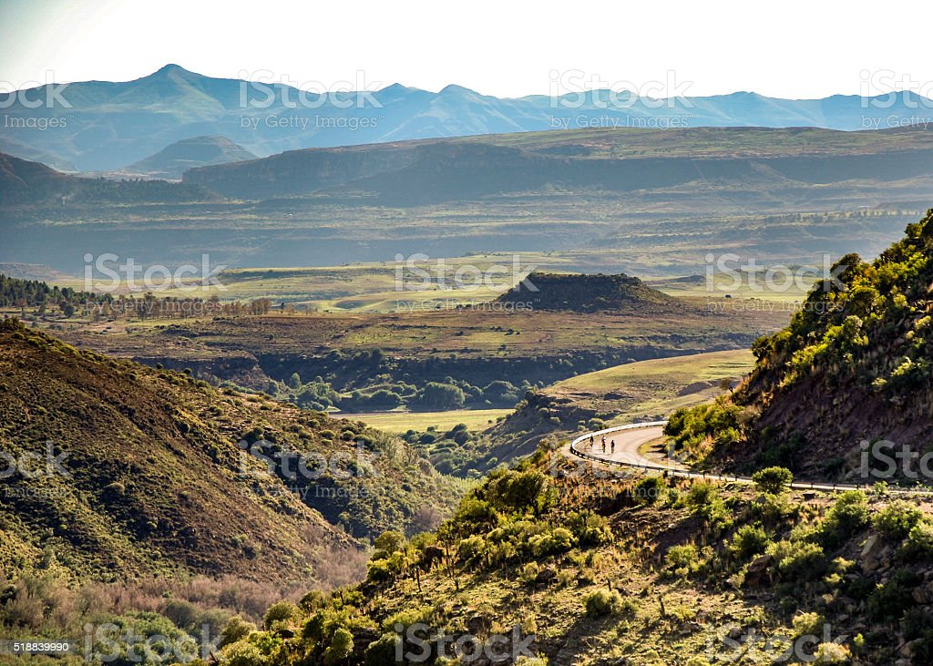 Cyclists taking a bend above the Senqu river Lesotho stock photo