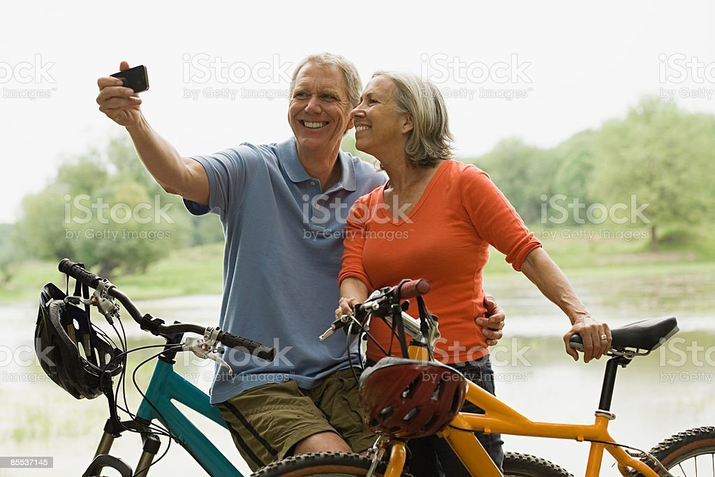 Cyclists with camera stock photo