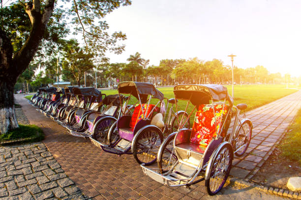 Cyclo (pedicab) Beautiful Color in Hue Province. Vietnam Cyclo (pedicab) Beautiful Color in Hue Province. Vietnam huế stock pictures, royalty-free photos & images