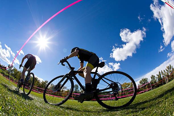 cyclo-cross racers - cyclocross stock-fotos und bilder