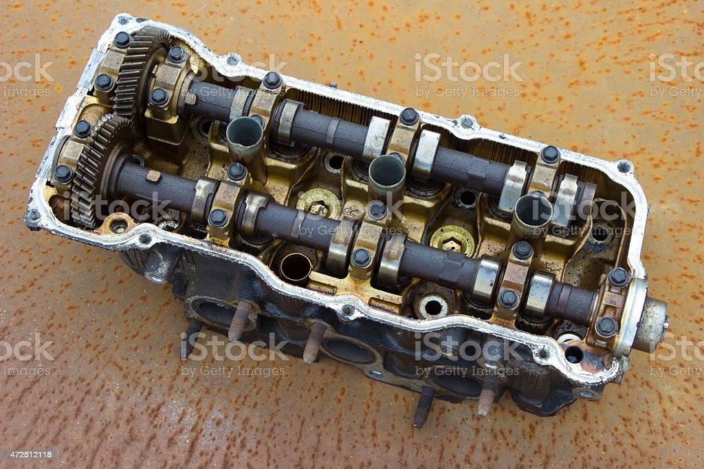 cylinder head on a rusty metal coating