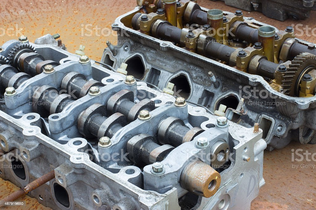 cylinder head on a rusty metal coating royalty-free stock photo