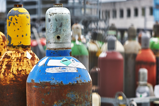 various gas bottles with safety caps