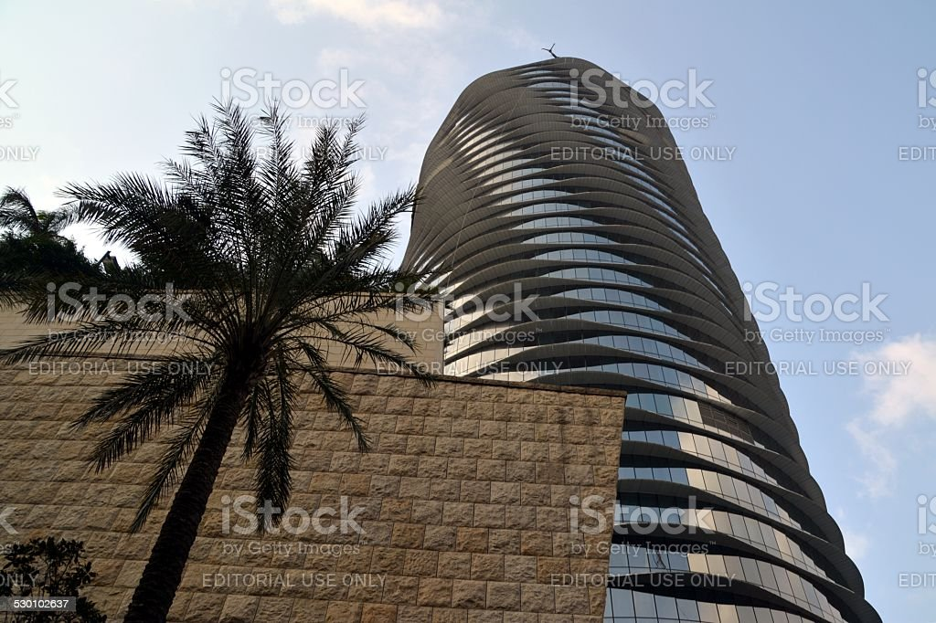 Hard Rock hotel silver cylindric building and casino in Macau, low...