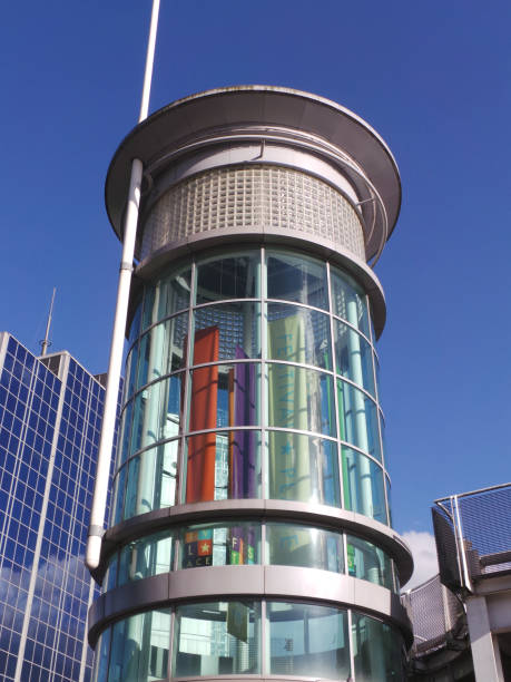 A Cylindrical glass tower that is the entrance to Festival Place shoping Centre stock photo