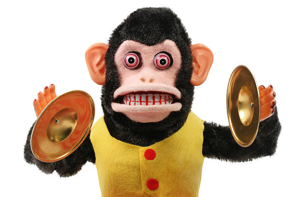 Cymbal Playing Monkey 1950's retro Cymbal-Playing Monkey in very good shape on a white background. cymbal stock pictures, royalty-free photos & images