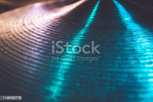Texture on a ride cymbal illuminated by LED lights.