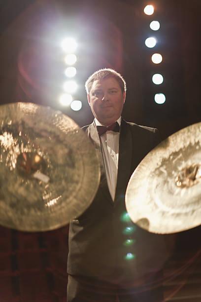 cymbals player in orchestra - cimbaal stockfoto's en -beelden