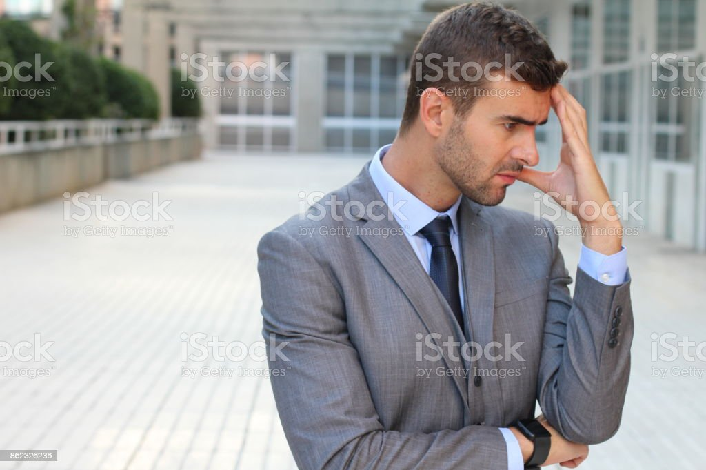 Cynical worker planning a revenge stock photo