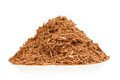Pile of red cypress mulch isolated on white.Please also see: