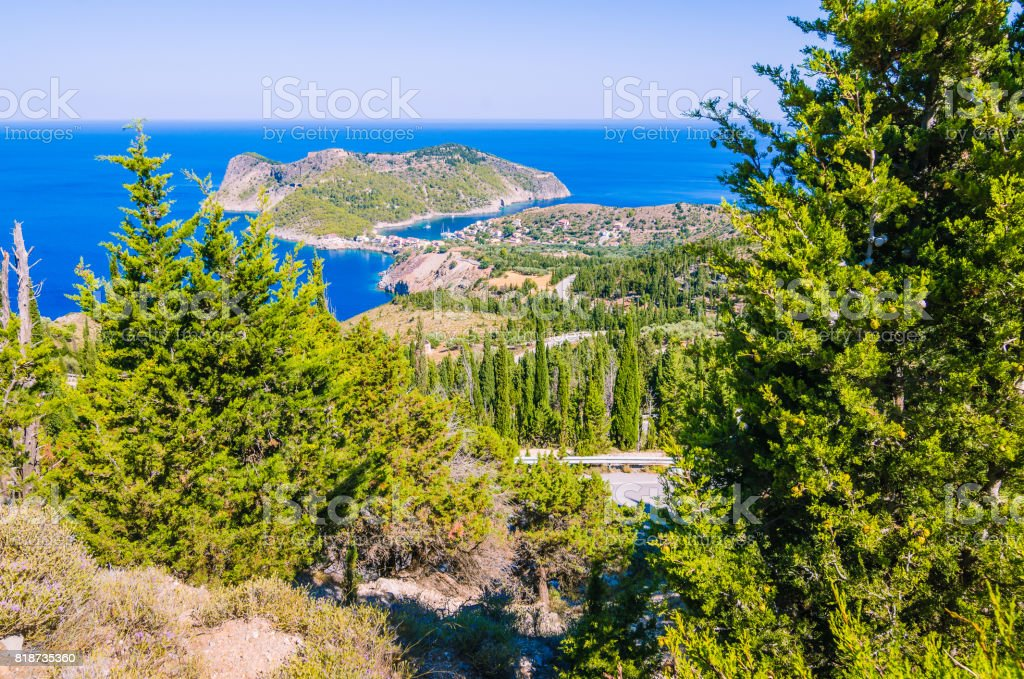 Cypress on a road lead to cute Asos village, Kefalonia in Greece stock photo