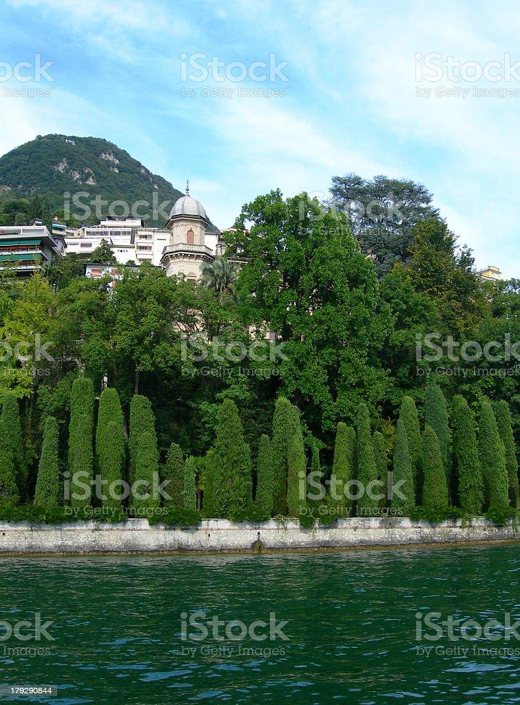 Cypress trees at lake Lugano in Switzerland royalty-free stock photo